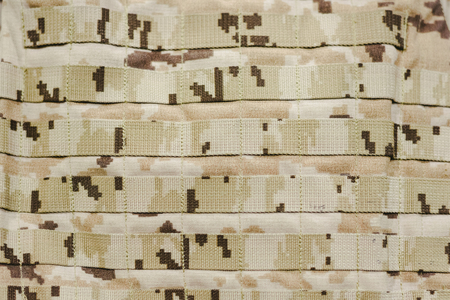 Detail of a military camouflage bulletproof vest. Imagens