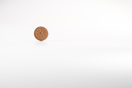 1 British pound coin falling on white background, isolated