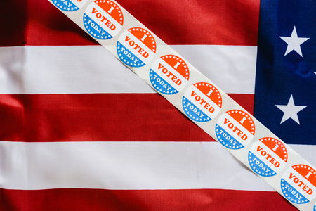 Sticker strip I vote today on the USA flag after voting in the ballot box.