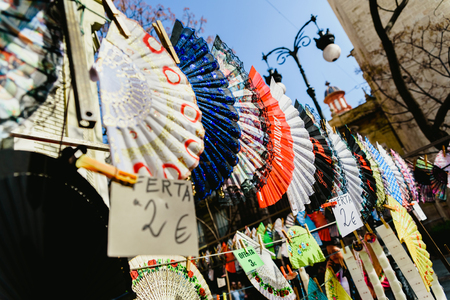 Valencia, Spain - February 24, 2019: Typical colorful Spanish flamenco fans for sale in a street market in spring.