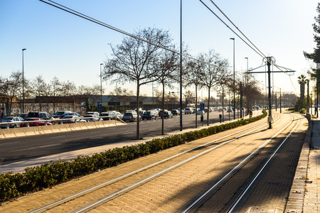 Valencia, Spain - February 28, 2019: Road congested by traffic jam next to empty bike lane and free tram lines, sustainable urban mobility. Editoriali