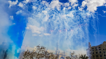 Fireworks fired in a Mascleta Fallas during the day.