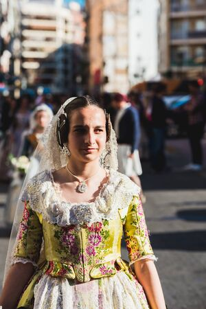 Valencia, Spain - March 17, 2019: Portrait of falleras women, wearing the traditional costume of Fallas on the day of the offering to the Virgin during the parade through the streets of Valencia of all commissions.