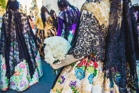 Detail of the traditional Spanish Valencian Fallera dress, colorful fabrics with intricate embroidery. 免版税图像