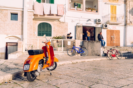 Bari, Italy - March 8, 2019: Young men spending time in a square in the Italian city of Bari.