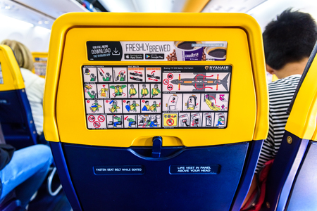 Valencia, Spain - March 8, 2019: Back of the seats of a Boeing plane with safety instructions, mandatory reading for passengers.