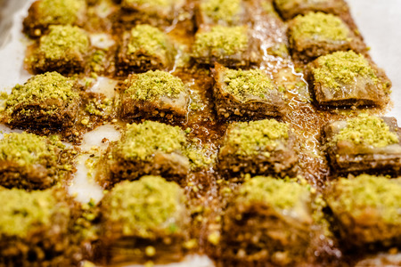 Detail of a tray full of delicious and sweet Turkish baklava dessert.