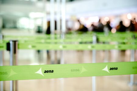 Valencia, Spain - March 8, 2019: Tapes to distribute passengers in the queues of the checkin desk in a Spanish airport managed by AENA.