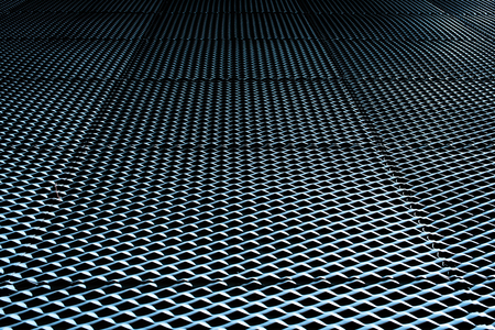 Industrial background with metallic texture illuminated with strong light and intense shadows and repetitive pattern.