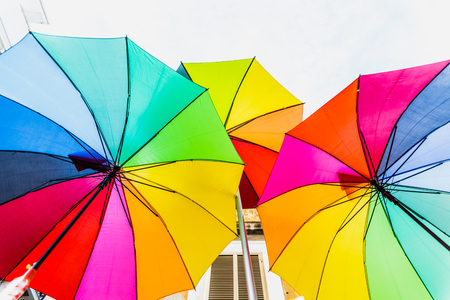 Colorful umbrellas to use as a background in bright and cheerful ideas. 免版税图像