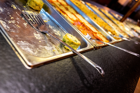 Trays with pasta dishes for self-service buffet in a restaurant.