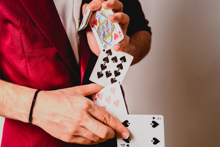 Young magician juggling a deck of playing cards. Stock Photo