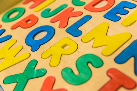 Alphabet with wooden letters in a children's classroom.