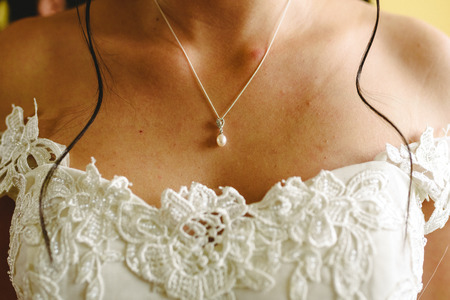 Womans chest on her wedding day while she dresses. Stock Photo
