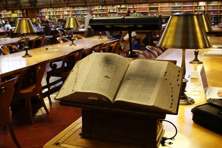 New york, usa- August 13, 2008: Ancient book, treaty of biology, opened in a lectern in a public library, headquarters of the knowledge of humanity.