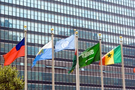 New york, usa- August 15, 2008: Flag of the UN and other countries waving in front of the official headquarters building.