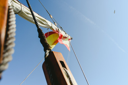 Rigging and ropes on an old sailing ship to sail in summer. Stock Photo