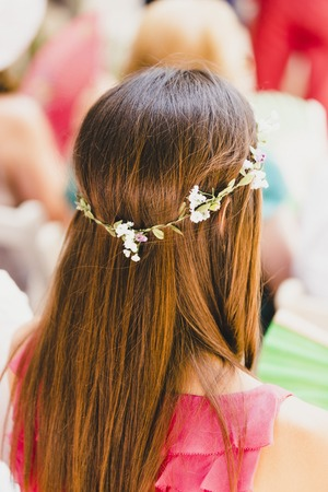 Woman with straight hair combed with a wreath of flowers in spring style. Stock Photo