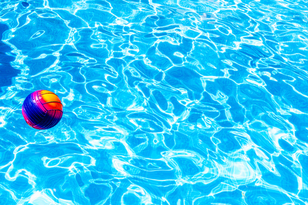 Water sports ball in a pool with fresh water to have fun.