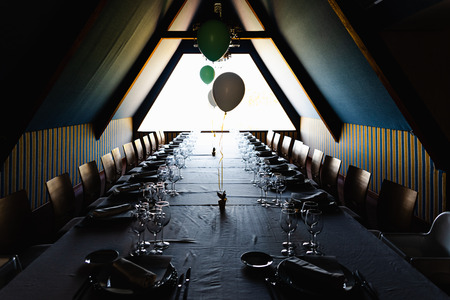 Interior of a house decorated with balloons and table without anyone ready to celebrate a childrens birthday.