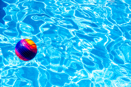 Colorful ball floating on a pool.