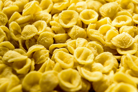 Close-up of Orecchiette, wheat semolina pasta made one by one by hand in a traditional way in the Italian region of Bari.