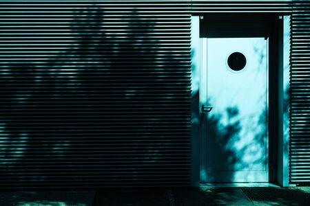 Emergency door in the back of office building.