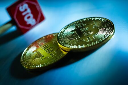 Crisis concept of bitcoin cryptocurrencies, stop investments. Stock Photo