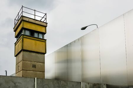 Berlin, Germany - June 6, 2019: Watchtower next to a wall on a border to control illegal immigrants. 에디토리얼