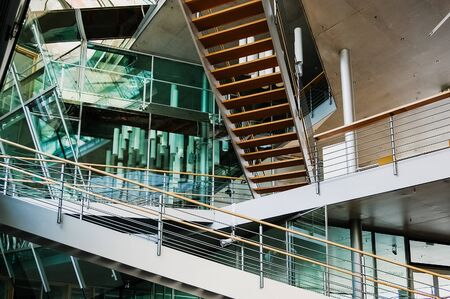 Berlin, Germany - June 1, 2019: Stairs that intersect inside an architectural design building with transparent crystals. Reklamní fotografie - 133984862