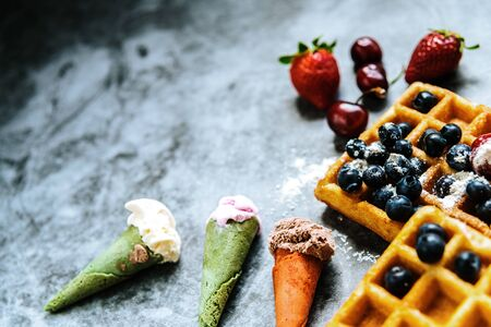 Appetizing ice cream with fruits and waffles, the ideal snack in a restaurant in summer. Imagens