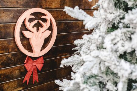 Christmas decoration, reindeer figure hanging on a wooden wall