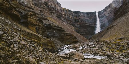 Panoramic photos of famous Icelandic waterfalls on cloudy days with geological formations.