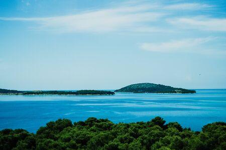 Croatian coast with islets and blue sky.