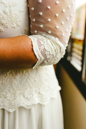 Elbow of a woman with wedding dress.