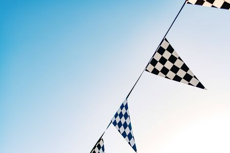 Hanging decoration pennants with the design of a checkered flag. Reklamní fotografie