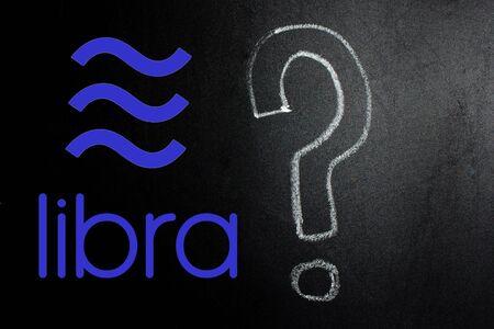 Question mark written by hand on a blackboard.