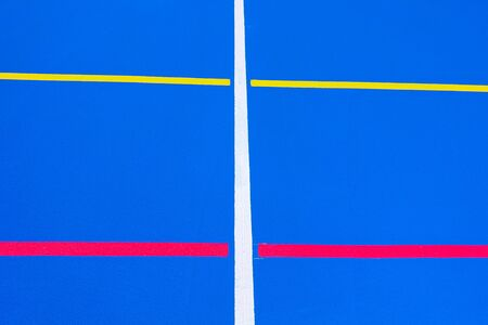 Design of a sports field, with blue background and red and yellow white lines creating strange straight lines and curves, to use with copy space.