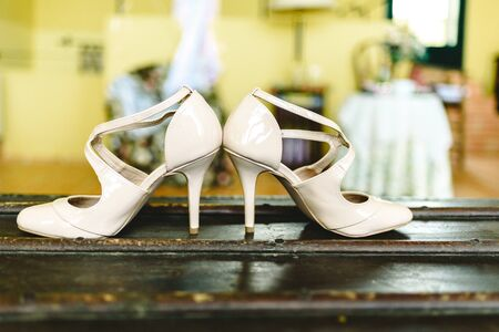 Pair of shiny white womens shoes for a special occasion, very elegant to party with high heels.