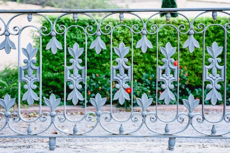 A private garden separated from the street by a metal fence. Reklamní fotografie