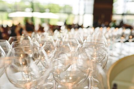 Group of empty and clean drink glasses ready for a party. Stockfoto