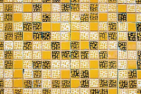 Orange colored tile background.