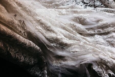 Detail of the texture of a white wedding dress.