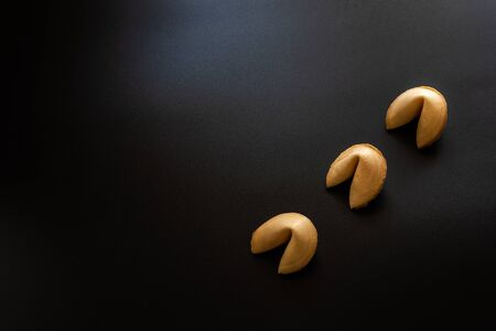 Fortune cookies on black background.
