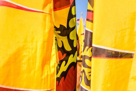 Flags of the brotherhood of Sbandieratori Di Fivizzano parading in a medieval festival.