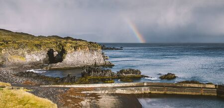 Rainbow over the Icelandic coast in the middle of nature. 写真素材