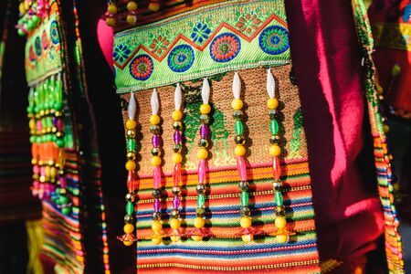 Detail of the colorful embroidery of a typical costume from the Andean folklore of Bolivia to dance the Tinku.
