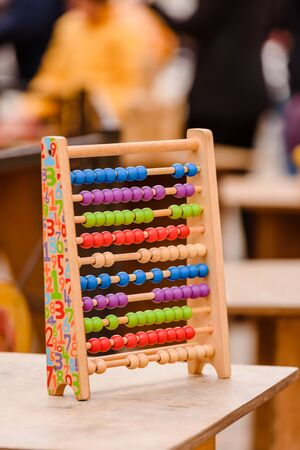 Montessori toy abacus in a school to learn how to count.