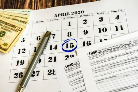 Tax payment day, marked on a calendar on April 15, 2020 Stock Photo - 128718641