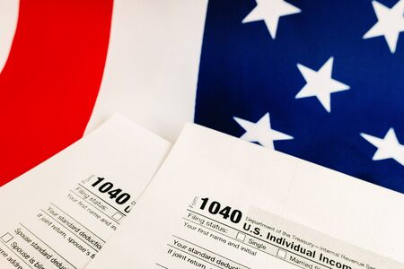 Form 1040 serves to pay federal taxes to the American government. Banque d'images - 128718307